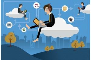 Guy Using Laptop in Cloud
